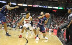 Josh Williams looks to pass against Louisville