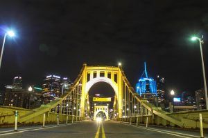 A single car drives over the Roberto Clemente Bridge. Photo Date: March 29, 2019) Photo Credit: (RMU Sentry Media/Gage Goulding)