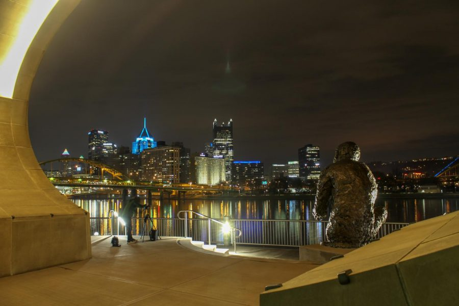 A statue of Mister Rogers looks over the Downtown Pittsburgh skyline from the Fred Rogers Memorial Statue on the North Shore. Photo Date: March 29, 2019 Photo Credit: (RMU Sentry Media/Gage Goulding)