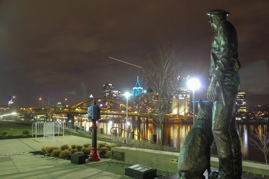 A monument of a police officer and their K9 dog watch over Downtown Pittsburgh from the Allegheny County Law Enforcement Officers Memorial on the North Shore. Photo Date: March 29, 2019 Photo Credit: (RMU Sentry Media/Gage Goulding)