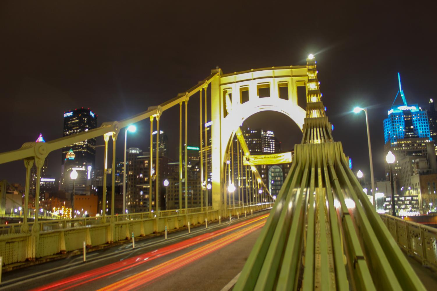 A car drives over the Roberto Clemente Bridge into downtown Pittsburgh. Photo Date: March 29, 2019. Photo Credit: (RMU Sentry Media/Gage Goulding)