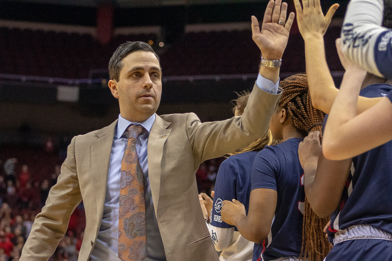 RMU head coach Charlie Buscaglia high fives his teammates as the final seconds wind down in the NCAA tournament. March 27, 2019 Louisville Ky. (Samuel Anthony/RMU Sentry Media)