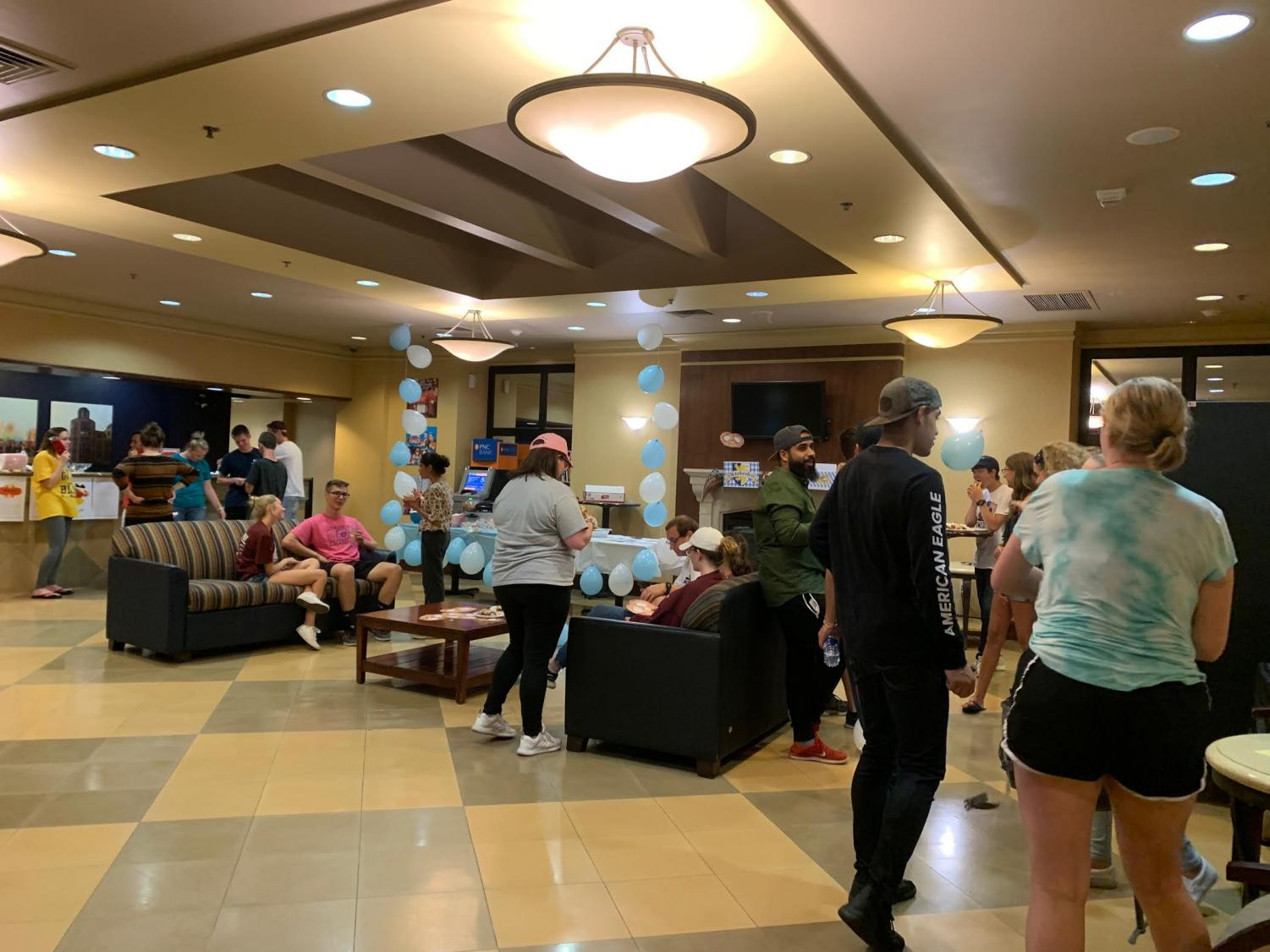 Students gathered in the Yorktown lobby to mingle and learn about German culture. Photo credit: Kassandra Boyd