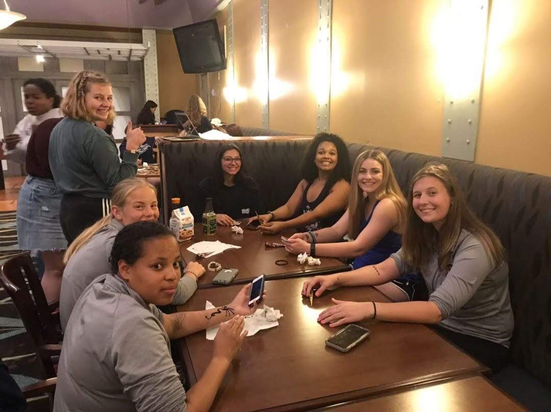 A group of students bonding and designing henna art. Photo credit: Lauren Comito