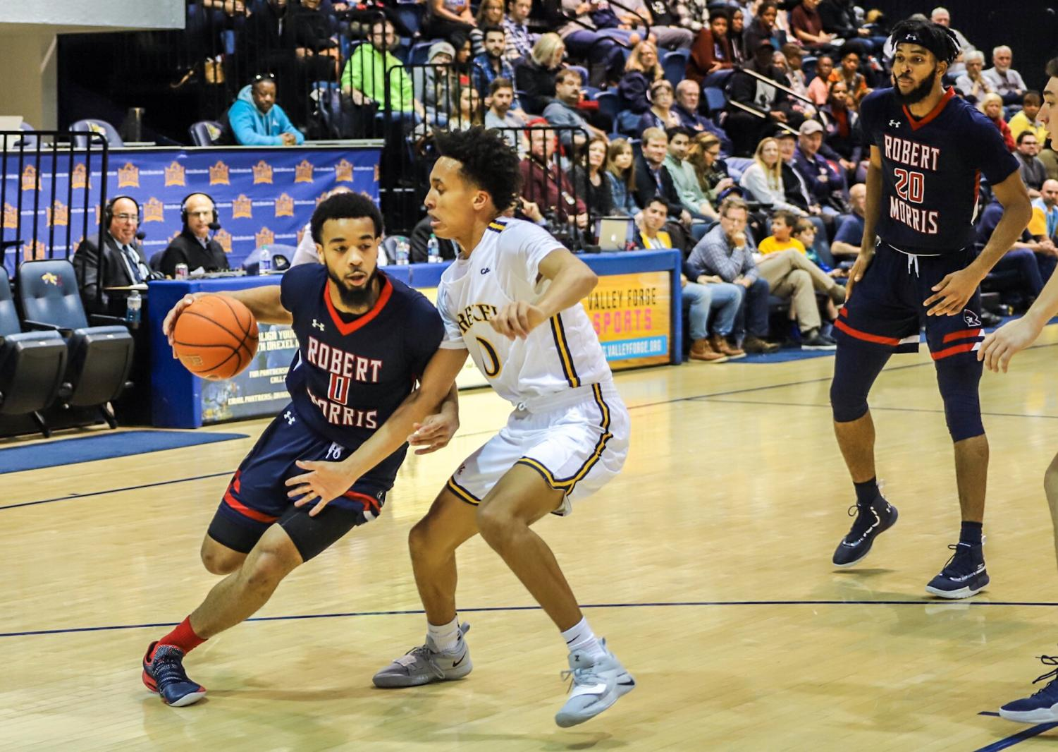 PHILADELPHIA - Josh Williams drives to the hoop against Drexel on 12/01/18. (Photo Credit: David Auth/RMU Sentry Media) Photo credit: David Auth