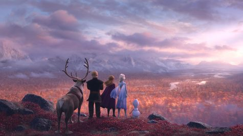 Sven, Kristoff, Anna, Elsa, and Olaf look into the distance. Photo credit: Disney Movies