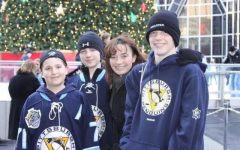A picture of my brothers, my mom, and myself. My mother was the most inspirational person I ever met, and this moment around the Winter Classic at the ice skating rink is one of many great memories spent with her.
