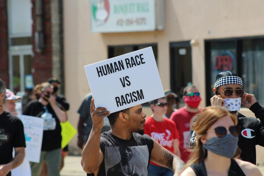 A protester raises his sign, which reads