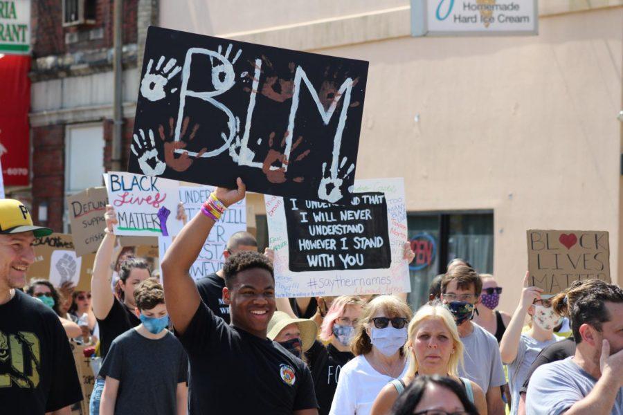 A protester raises his