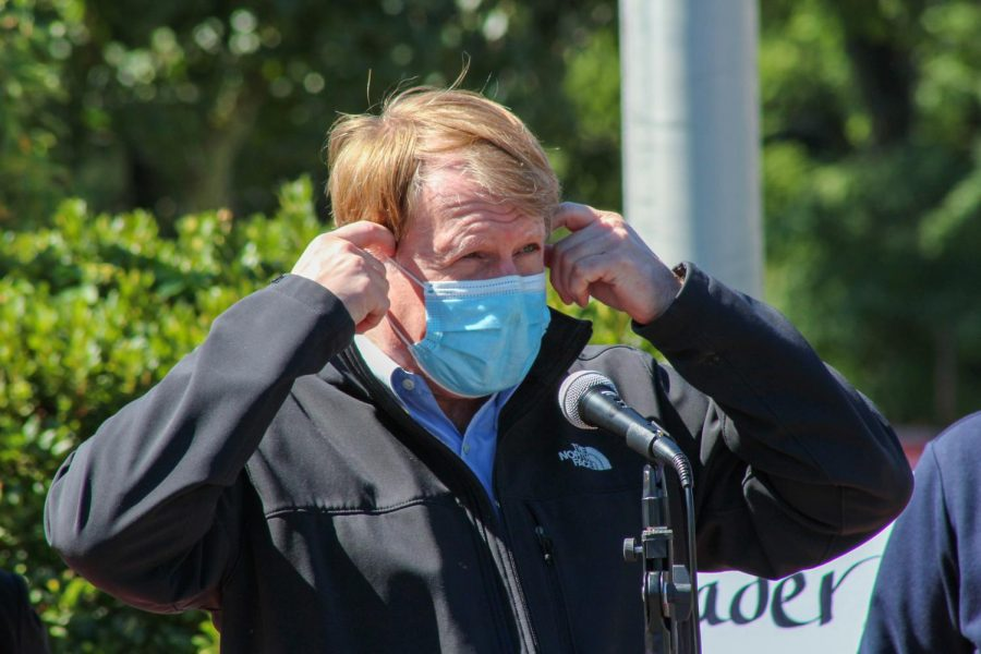 Allegheny County Executive Rich Fitzgerald walks up to the microphone before removing his mask to speak to the audience.