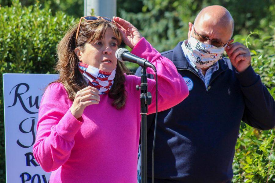 Representative Anita Kulik prepares to speak to the audience and rally them to vote blue this Fall.