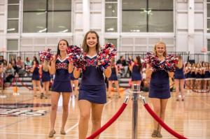 The RMU cheerleaders ready the crowd for the entrance of the basketball teams.
