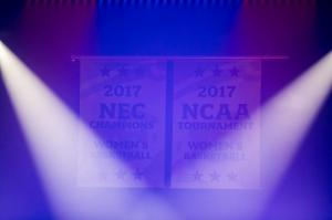 The NCAA Championship banners are lit by the laser light show.