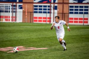 #8, Kai Olguin, runs for the ball.